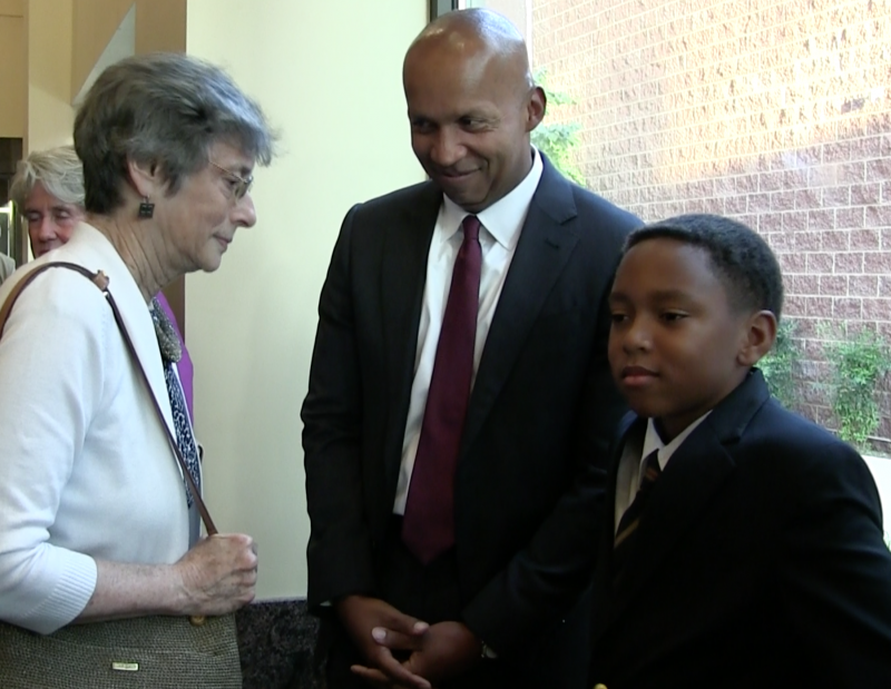 Attorney Bryan Stevenson stands with his nephew. Stevenson is a Milton native.
