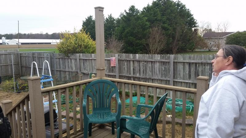 Cheri Zatko-Coseglia looks out over her backyard at