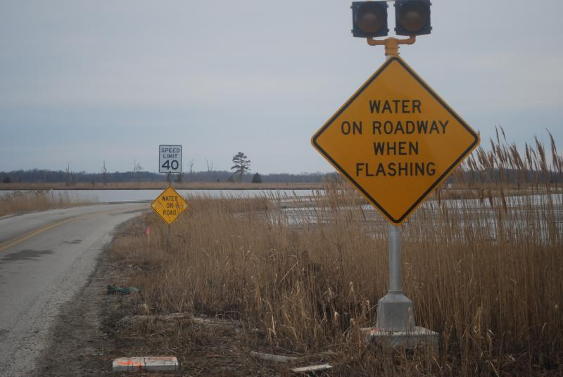 Residents of Prime Hook Beach have been frequently stranded by flooding across this road linking their barrier island with the mainland. They are looking forward to the construction of a new bridge, scheduled to begin in mid-February.
