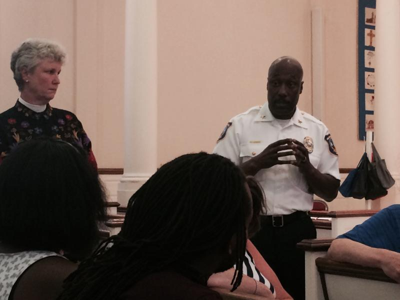 Rev. Patricia Downing, left, and Wilmington Police Chief Bobby Cummings discuss community policing solutions Monday night during a Delaware Coalition to Dismantle the New Jim Crow meeting.