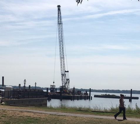 Work is beginning to rebuild a 170-foot pier at the foot of Delaware Street