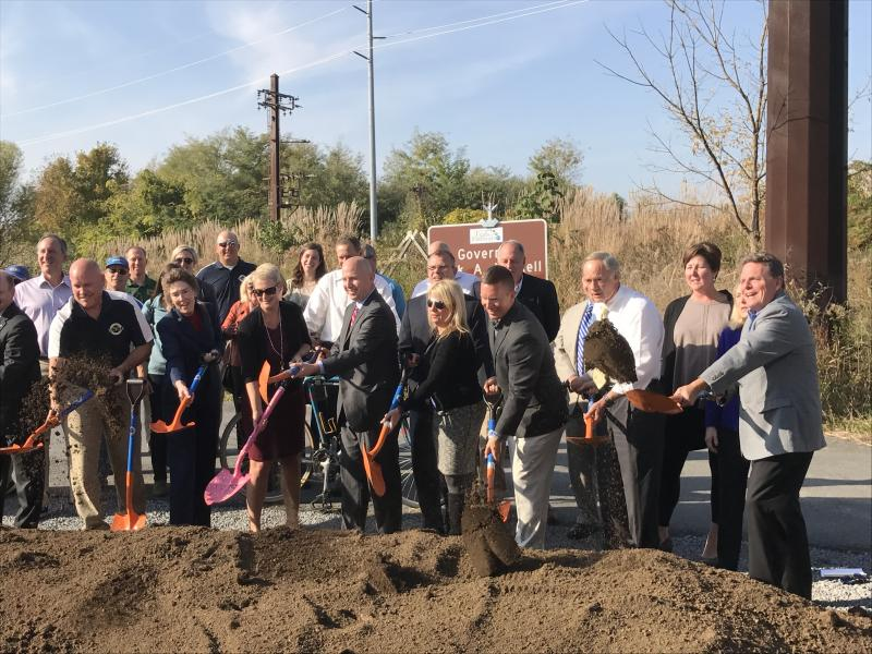 Gov. Jack Markell and others participate in a groundbreaking ceremony for the final leg of the Industrial Track Trail.