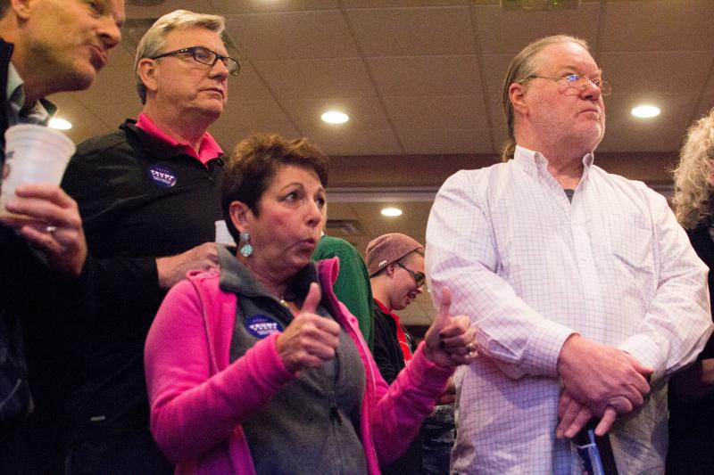 Republican Party faithful excitedly watch election results pour in Tuesday night at Grotto Pizza in Dover.