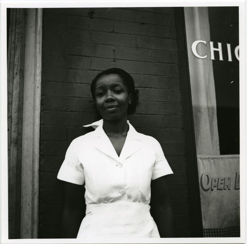 Elsie of Elsie's Chicken Shack on Walnut St. poses outside the restaurant in 1940.