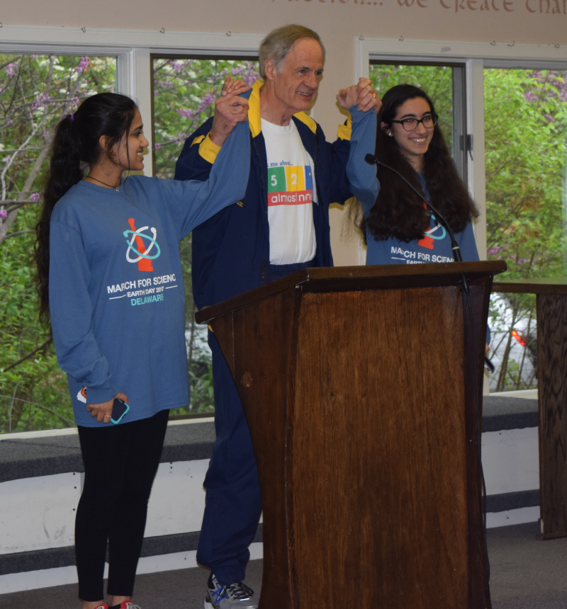 Vyshnavi Kosigishroff and Dounya Ramadan, two of the organizers of the Delaware March for Science, stand with Senator Carper to kick off the march.