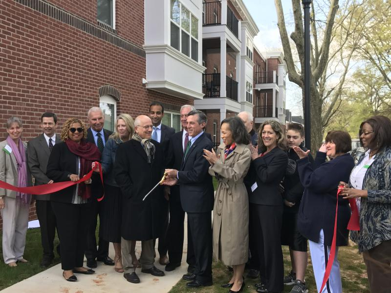 A ribbon-cutting ceremony was held Wednesday morning to signify completion of phase one of The Flats redevelopment project.