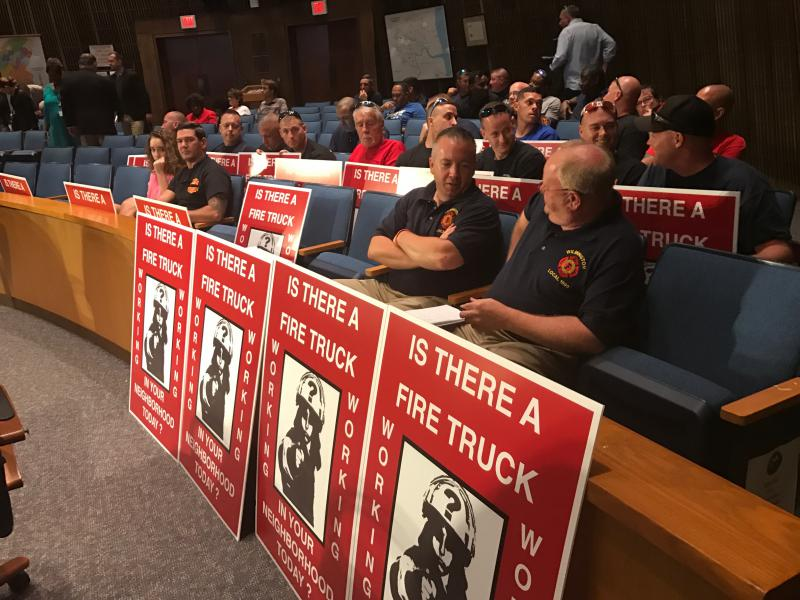 Wilmington firefighters prepare to protest during Thursday night's city council meeting.