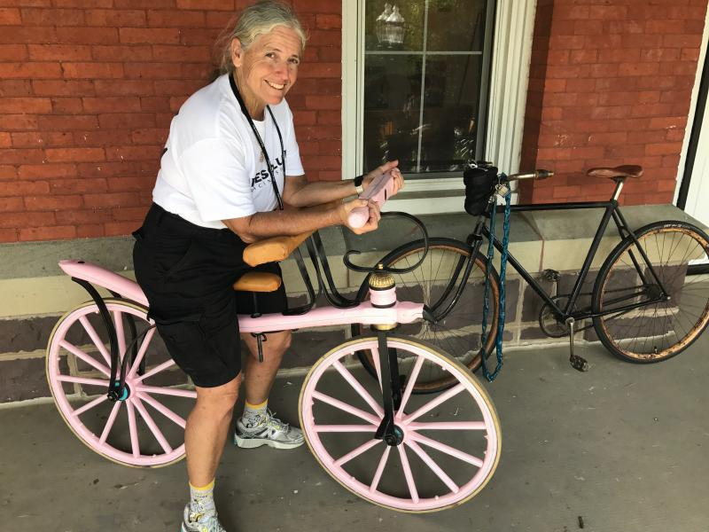Florida resident Diane Blake demonstrates how to ride her draisine, which pre-dates the bicycle.