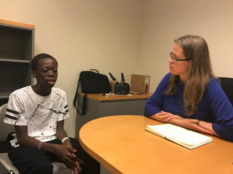 14-year-old Baraka Osborne talks to TeenSHARP Executive Director and Co-founder Tatiana Poladko about his progress in school.