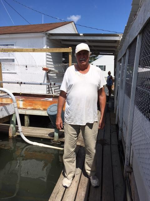 Roland Bradshaw at his dock on Smith Island