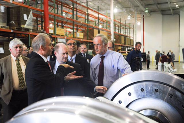 Sens. Carper and Coons tour new Siemens locomotive hub in New Castle.