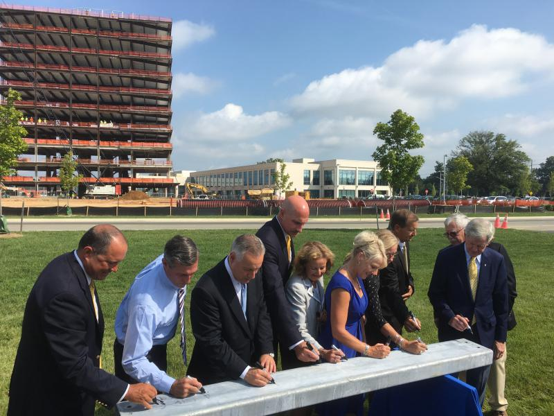 Dignitaries, including Gov. John Carney and UD Presidnet Dennis Assanis, sign the final STAR Tower beam before it's put in place