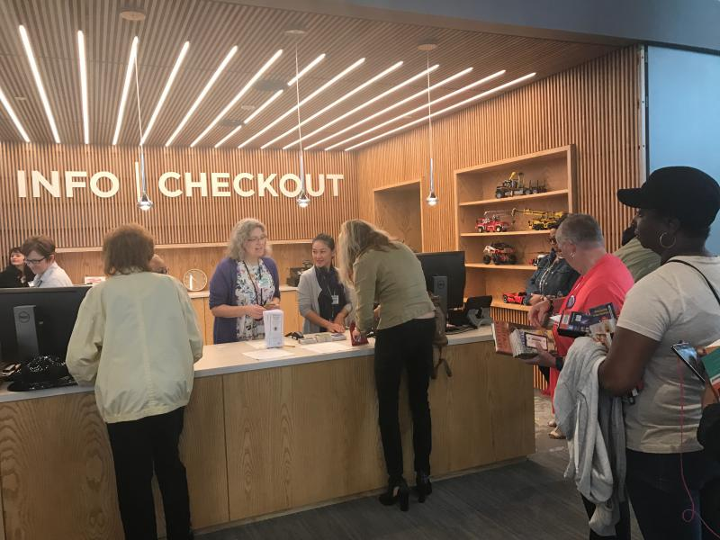 Residents check out books at the Route 9 library on its first day open Tuesday.