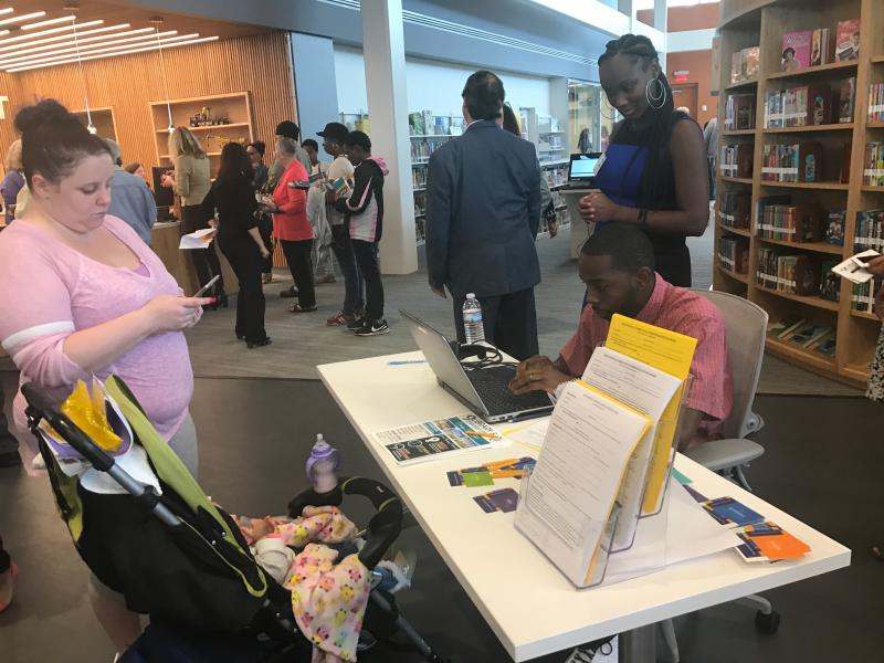 Residents signed up for library cards Tuesday.