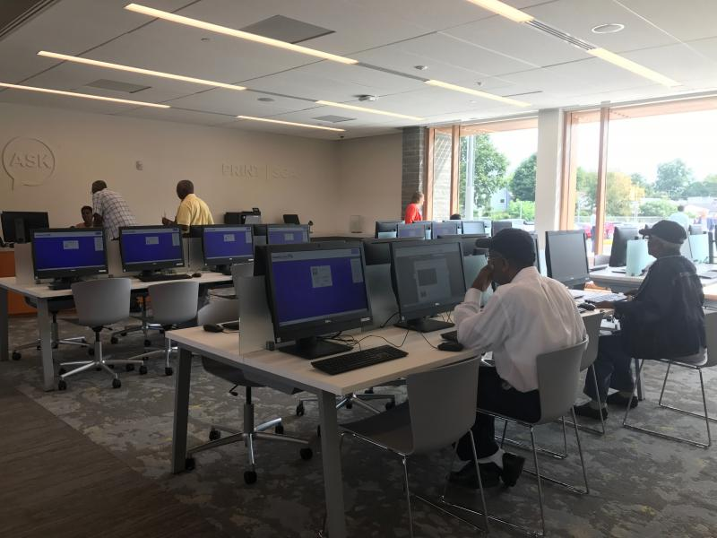 Residents began using Route 9 library services after the facility's doors opened at 10 a.m. Tuesday.