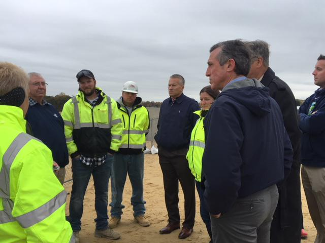 Carney talks with DELDOT workers. Rep. Lyndon Yearick is standing center in the picture.