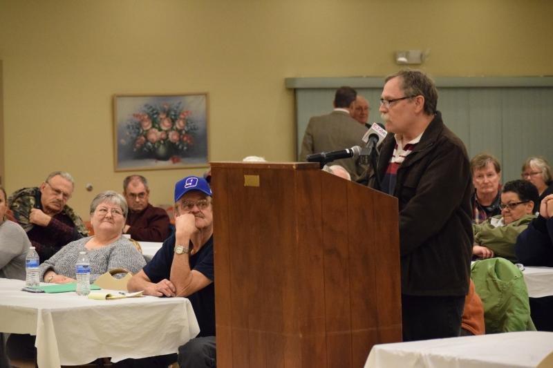 Resident Keith Steck speaks at a public hearing between Mountaire and nearby residents.