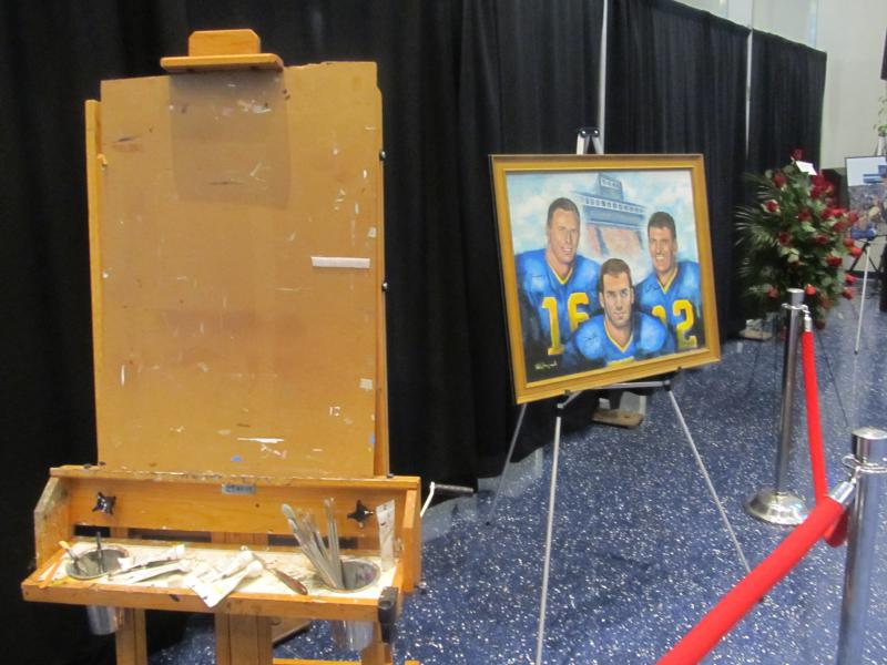 The easel Tubby Raymond used to paint player portraits and other works is displayed at his memorial service