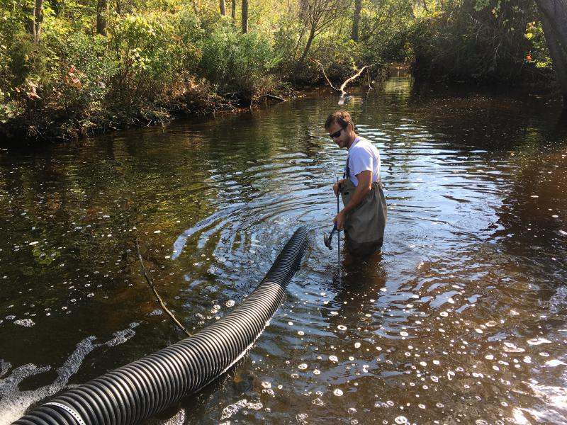 Environmental scientist Andrew McGowan installs an eelway at Burton's Pond.