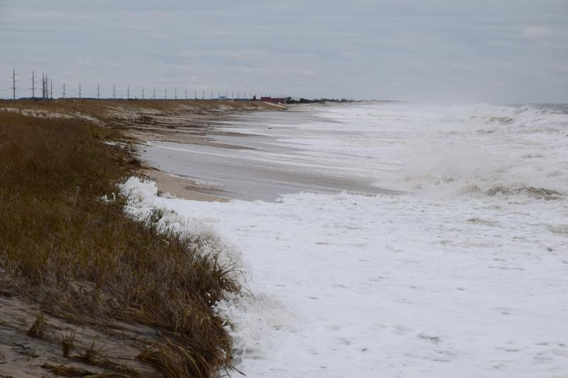 Minor dune impacts to the dune north of Indian River Inlet