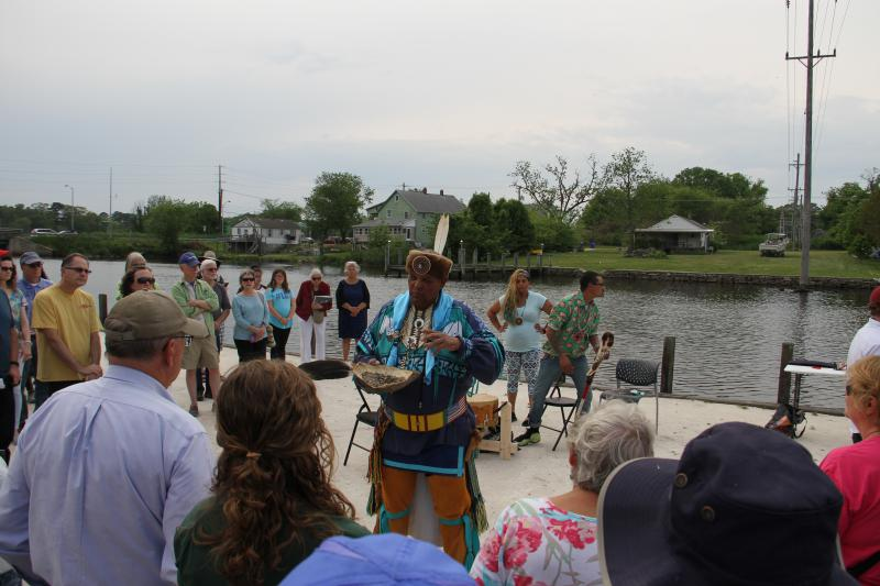 Herman Jackson from the Nanticoke Tribe performs a ceremonial blessing of the river.