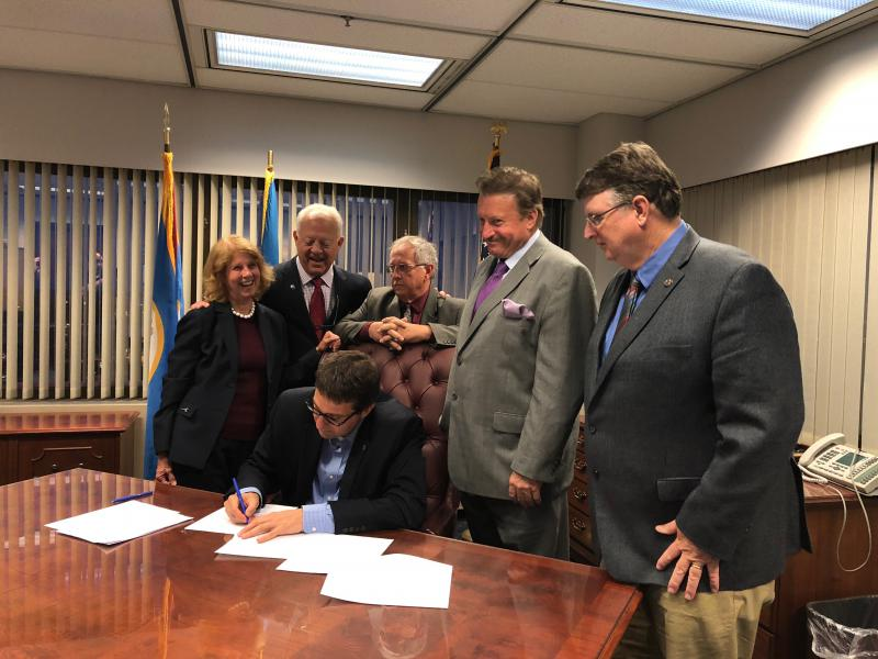 County Executive Matt Meyer signs the County's operating budget for FY2019 after it passes County Council