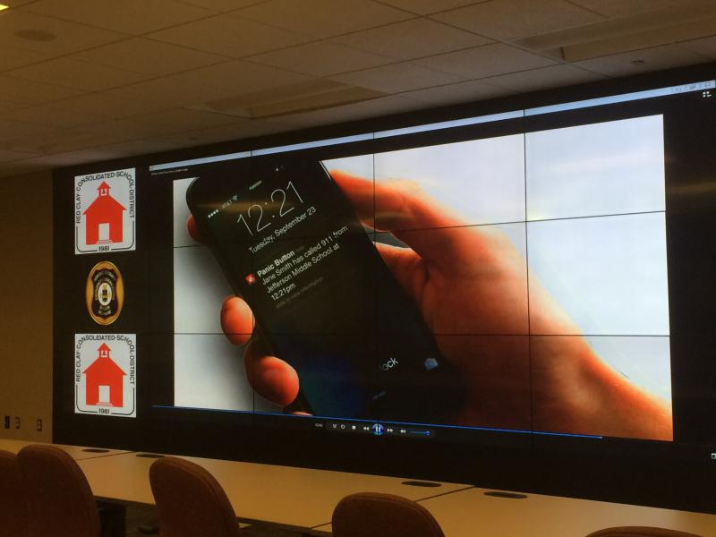 New Castle County Division of Emergency Communication demonstrates how the Rave Panic Button app works in a school setting