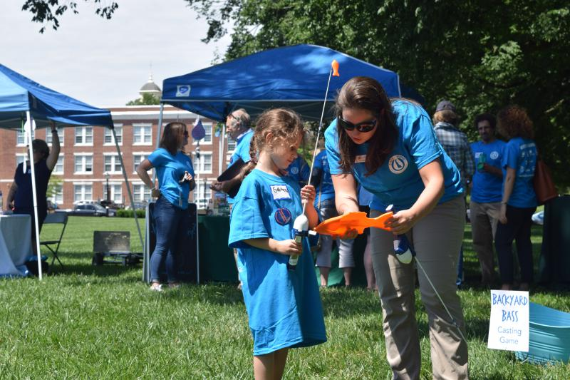Amy Barra from the Delaware Center for the Inland Bays tells Gabrielle Feliberty about a species of fish during a game at the Clean Water Rally.
