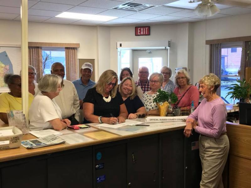 Ellen Magee (center) files for Sussex County Council