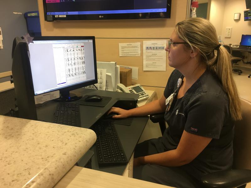 Christiana Care Health System Tech Sara Gibbons observing video surveillance and EEG readings of patients in the Epilepsy Monitoring Unit