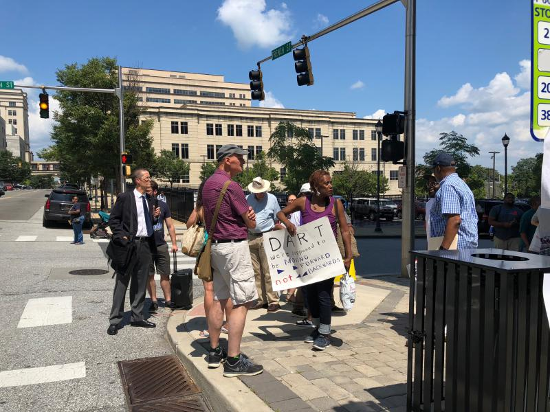 Bus advocates gather outside of the Governor's building in Wilmington