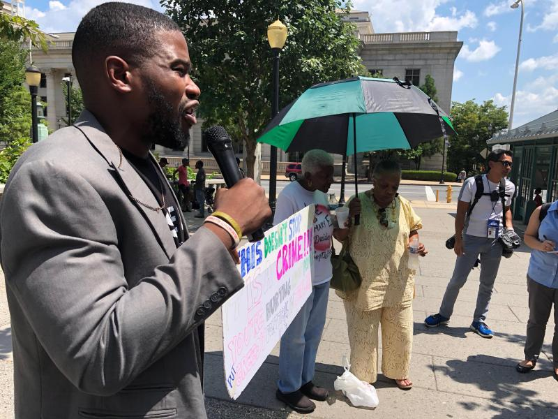 Wilmington activist D. Marque Hall speaks at the rally