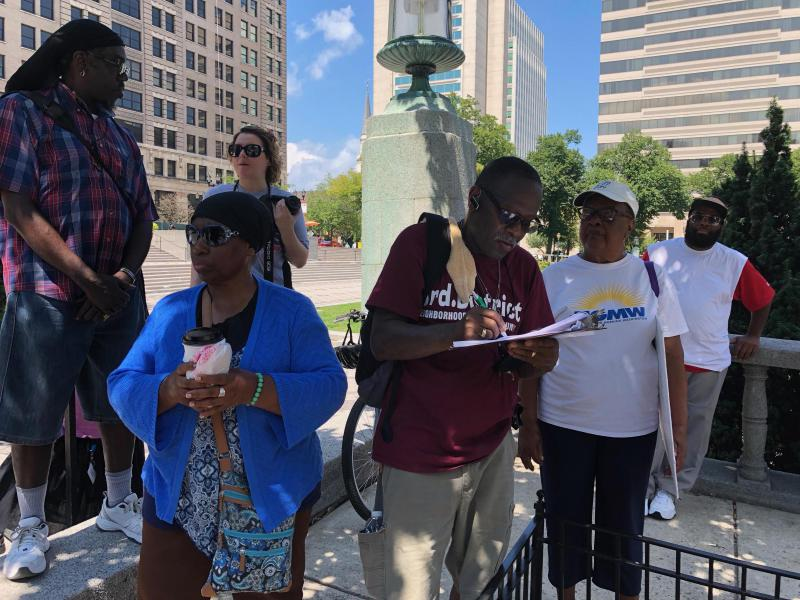 Citizens sign the Coalition to Restore Bus Service on Rodney Square's petition