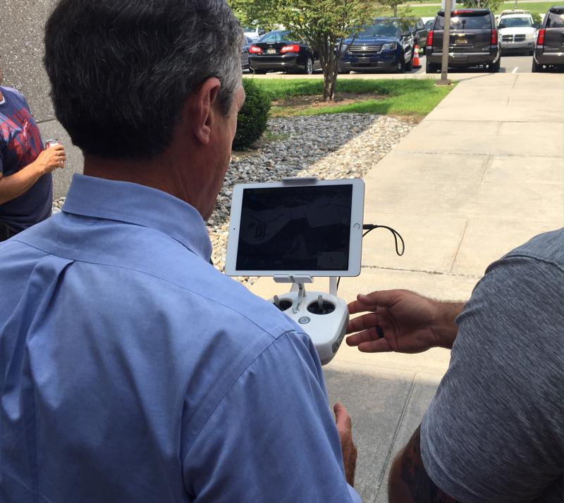 Gov. John Carney shown how to operate a drone