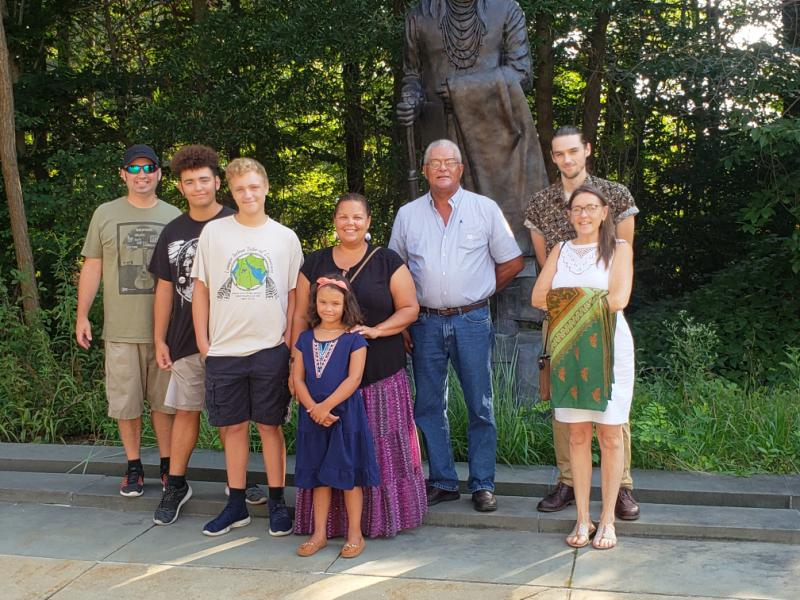 The group poses in front of a statue of Chief Joseph at the Cultural Resources Center in Suitland, Md.