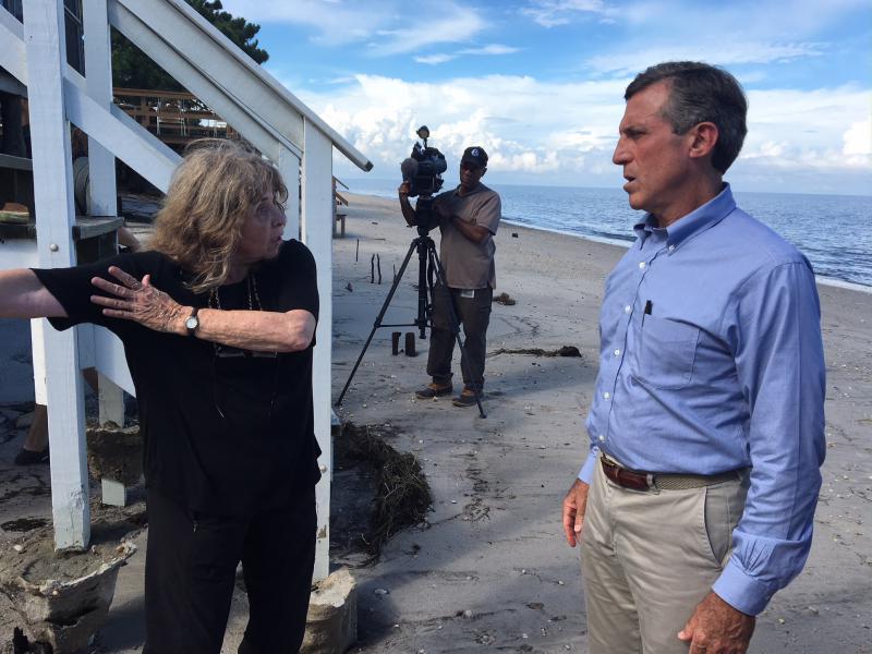 Gov. John Carney listens to Pickering Beach resident Gwen North
