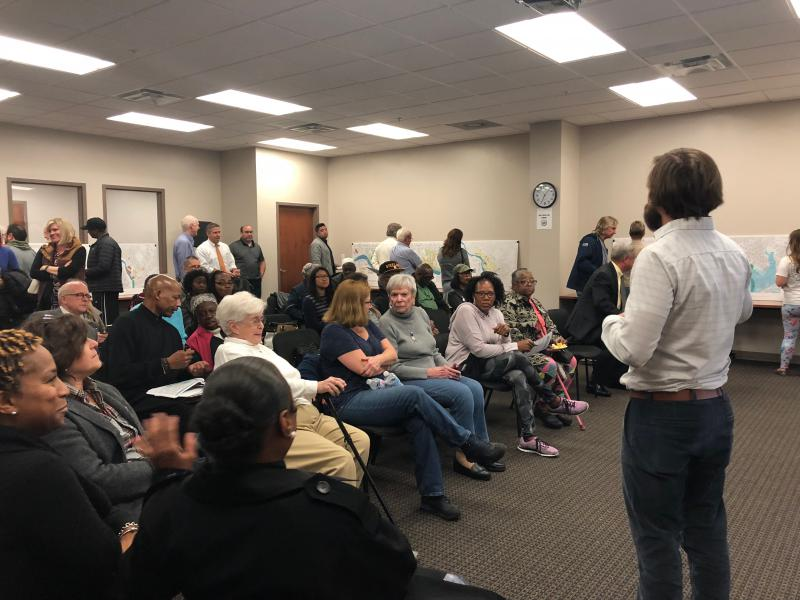 City planner Matt Harris talks to residents of the study area and other concerned citizens