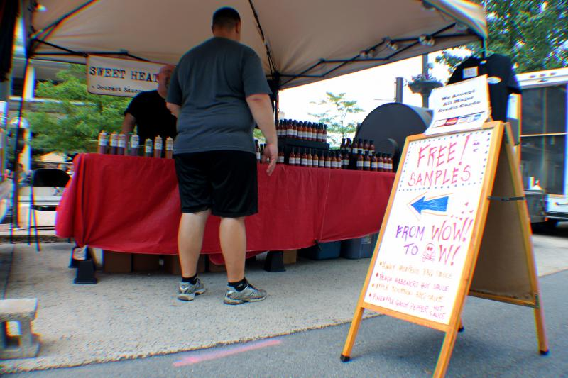 Sweet Heat Gourmet from State College, PA dishing out some free samples of hot sauces.