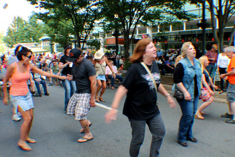 The crowd dances during B.C. Combo's performance.