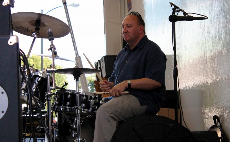 Allentown Mayor Ed Pawlowski sits behind the kit for a song during B.C. Combo's performance.