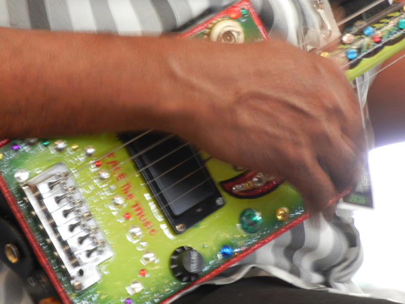 "Close-up of Super Chikan's ""Face the Music"" cigar box guitar"