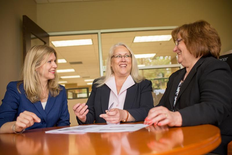 Laurie A. Siebert,CPA, CFP®, AEP® (center)