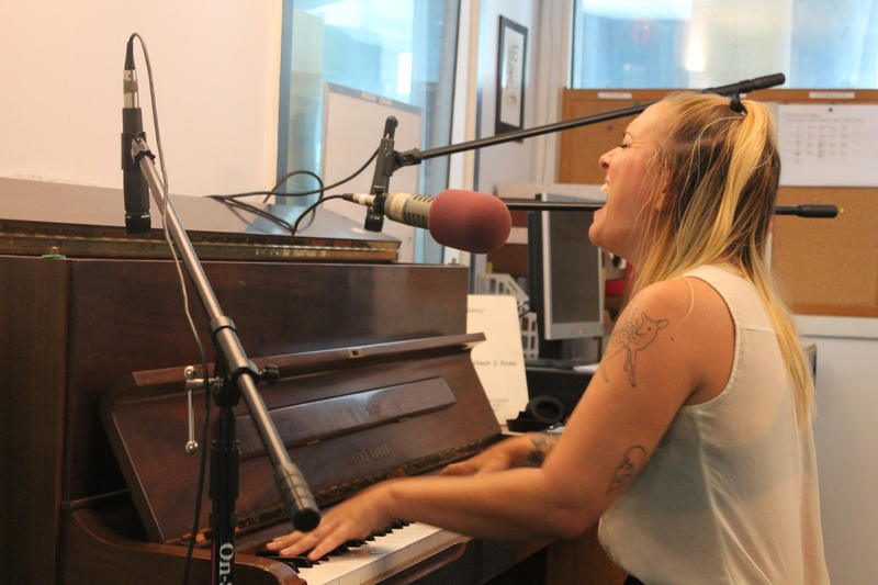 Carly Comando of Slingshot Dakota plays WDIY's station piano.