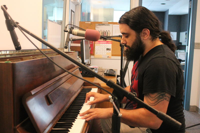 Richie Ares playing WDIY's station piano.