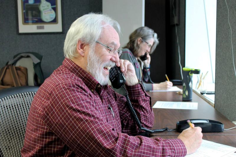WDIY volunteer Norm Williams answers phones during WDIY's Membership Drive.