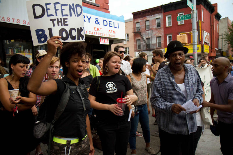 NYC residents banding together to prevent the eviction of an elderly Bed-Stuy homeowner, 2011.