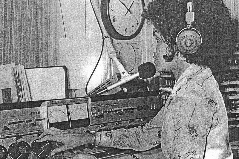 Rev. Dr. Debyii Sababu-Thomas on the air at WEAA in 1977.