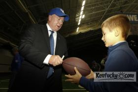 New UK head football coach Mark Stoops signed a ball for 7 year old Leighton Harris, on Sunday December 2, 2012 in Lexington.