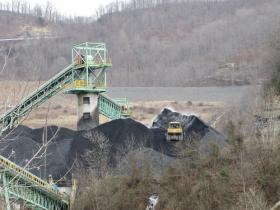 A bulldozer moved coal at a processing tower at an Arch Minerals facility in Knott County on Wednesday. The company closed the underground mine at the site, but still uses a coal-processing facility and a tipple to load rail cars.