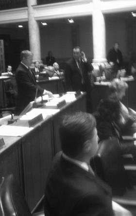 Majority Floor Leader Damon Thayer at the microphone and Minority Floor Leader R.J. Palmer in the aisle.